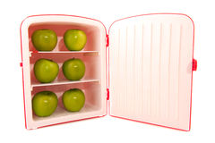 Refridgerator with green apples Royalty Free Stock Photos