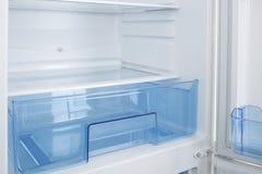 Refrigerador branco no fundo branco Imagem de Stock