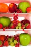 Refrigerador com fruta fresca Fotografia de Stock