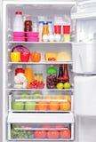 Refrigerador completamente de produtos saudáveis Imagem de Stock Royalty Free