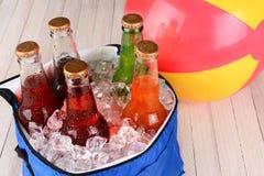Refrigerador con soda y Beachball Fotografía de archivo
