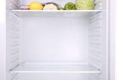 Refrigerador meio vazio Imagem de Stock Royalty Free
