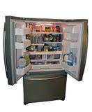 Refrigerador moderno con el alimento Fotografía de archivo libre de regalías
