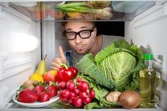 Refrigerador por completo de frutas y verduras Imagen de archivo libre de regalías