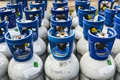 Refrigerant gas cylinders under pressure ready to transport Stock Images