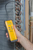 Refrigerant Leak Detection. Searching for a refrigerant leak on a residential evaporator coil Royalty Free Stock Images