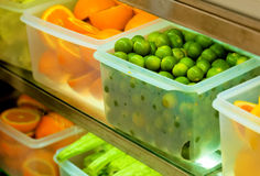 Refrigerated Fruits In The Transparent Crisper. Refrigerated Fresh Fruits In The Transparent Crisper Royalty Free Stock Photography