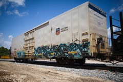 Refrigerated rail car. On rail road with blue sky background royalty free stock image