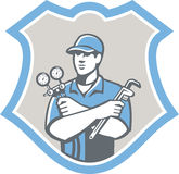 Refrigeration Air Conditioning Mechanic Shield. Illustration of a refrigeration and air conditioning mechanic holding a pressure temperature gauge and ac Stock Images