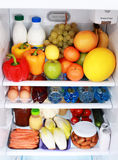Refrigerator. Full of healthy eating - food and drink Royalty Free Stock Photo