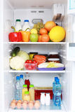 Refrigerator. Full of healthy eating - food and drink Stock Image