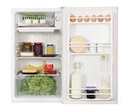 Refrigerator. Opened white refrigerator full of foodstuff Royalty Free Stock Images