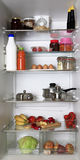 Refrigerator. The refrigerator, filled with different food stuffs Stock Image