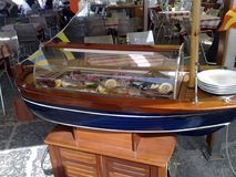 Refrigerator boat containing fish in a restaurant. In Sorrento Italy, on the small marina port Royalty Free Stock Images