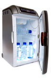 Refrigerator with bottles of water Stock Photo