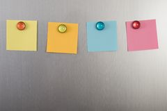 Refrigerator with colorful notes Stock Photos