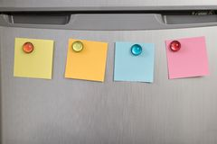 Refrigerator with colorful notes Royalty Free Stock Photography