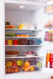 Refrigerator with food Stock Images