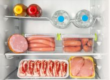Refrigerator with fresh meat products,. Closeup Royalty Free Stock Image