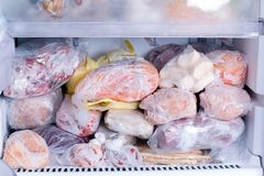 Refrigerator with frozen food. Open fridge freezer meat, milk, vegetables. Refrigerator with frozen food. Open fridge freezer meat, vegetables stock photo