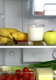 Refrigerator with fruits and vegetables Stock Images