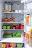 Refrigerator full of food. Refrigerator full of the  food Royalty Free Stock Image