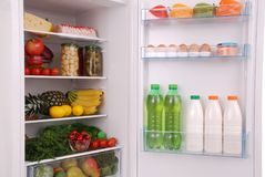 Refrigerator full of food. Open refrigerator full with some kinds of food and drinks Stock Photo