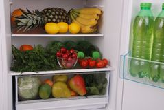 Refrigerator full of food. Open refrigerator full with some kinds of food and drinks Stock Image