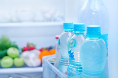 Refrigerator. Full of food, water in bottles Royalty Free Stock Photos