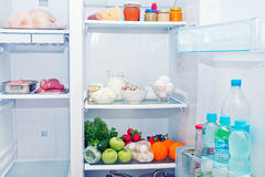Refrigerator. Full of food, water in bottles Stock Image