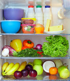 Refrigerator full of healthy food. Fruits, vegetables and dairy products Royalty Free Stock Images