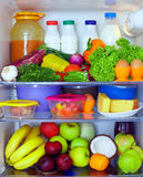 Refrigerator full of healthy food. Fruits, vegetables and dairy products Stock Images