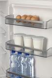 Refrigerator full of milk, eggs Royalty Free Stock Photos