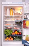 Refrigerator full with some kinds of food. Vegetables, meat, fish Royalty Free Stock Photos