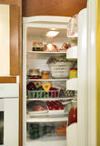 Refrigerator full with some kinds of food royalty free stock image