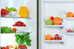 Refrigerator with healthy food fruits and vegetables Royalty Free Stock Photos