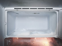 Refrigerator with ice Frozen in fridge Stock Image