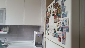 refrigerator with lots of magnets , water purifier