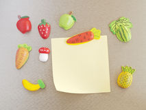 Refrigerator magnets. In the shape of fruits, vegetables and note paper Royalty Free Stock Photos