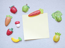 Refrigerator magnets. In the shape of fruits, vegetables and note paper Royalty Free Stock Images