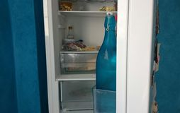 Refrigerator. Part of open refrigerator with a blue background wall Stock Photos
