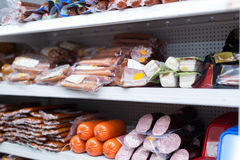 Refrigerator shelves with meat products Stock Image