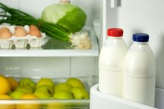 Refrigerator with some kinds of food. Fruits, vegetable, eggs and milk Royalty Free Stock Photography