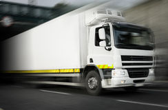 Refrigerator Truck  in motion. White refrigerator Truck  in motion On The Highway Royalty Free Stock Photo