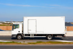 Refrigerator Truck in motion Stock Photo