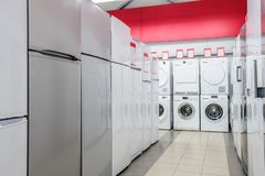 Refrigerators and washing mashines in appliance store stock photography