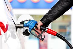 Refuel car with petrol. At the refuel station Stock Images