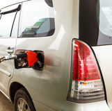 Refuel gasoline to car by nozzle pump Stock Photography