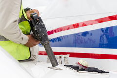 Refuel the small plain in close up Royalty Free Stock Photo