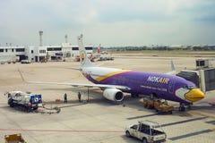 Refueling aircraft at aerodrome, Bangkok, Thai. Bangkok, Thailand - 20 February 2018: Refueling aircraft at aerodrome. Aviation tanker truck refuels passenger stock images